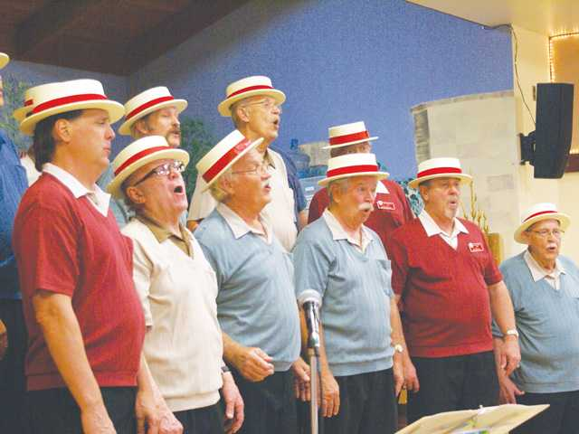 Members of the SCV Men of Harmony Chorus sing a song during the 38th annual A Capella Harmony Show and Ice Cream Social at the Senior Center on Sunday. Signal photo by Jim Holt.