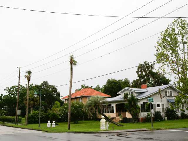 In this July 16, 2014 photo, several homes are seen on a quiet street in Fruitland Park, Fla. Two police officers are no longer with the city department here after a law enforcement report tied them to the Ku Klux Klan. (AP Photo/John Raoux)