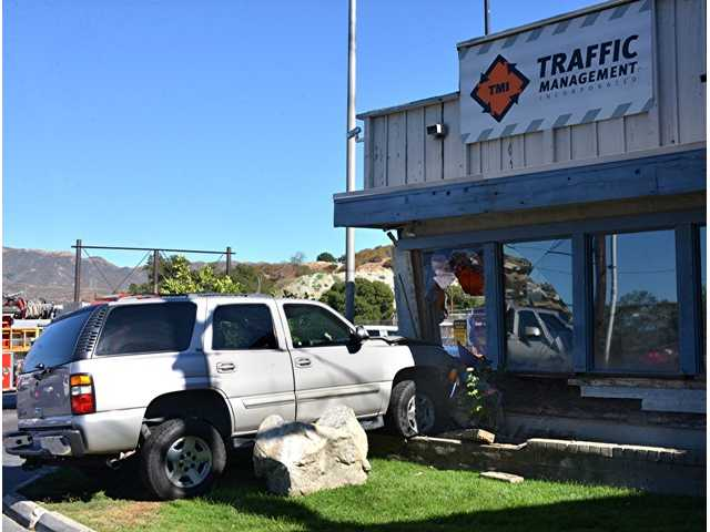 An SUV crashed into a building in Newhall at around 4:20 p.m. on Tuesday. Photo by Rick McClure/For the Signal.