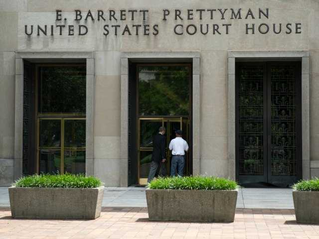A view of the E. Barrett Prettyman Federal Courthouse that houses the U.S. Court of Appeals for the D.C. Circuit, on Tuesday, July 22, 2014, in Washington. Obama's health care law is enmeshed in another big legal battle after two federal appeals courts issued contradictory rulings on a key financing issue within hours of each other Tuesday.