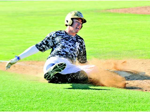 Saugus' Brendan Griffith slides into first base during their VIBL game versus Hart at Saugus High School on Tuesday. The Centurions beat Hart 8-3 in a rematch of last year's VIBL championship game.
