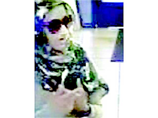 "This image, taken from a bank surveillance camera, shows a woman dubbed the ""Bombshell Bandit,"" who is suspected in three bank robberies, including one in Valencia. Photo courtesy the FBI."