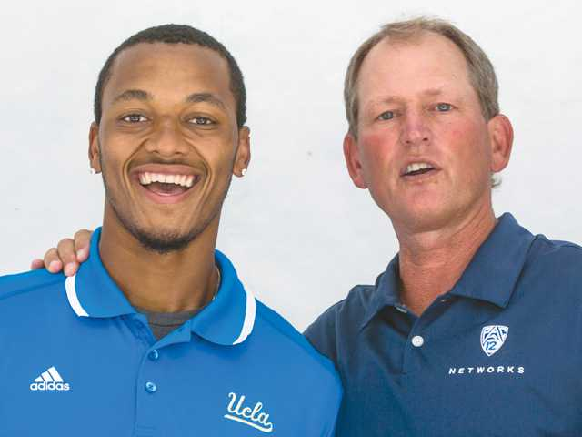 "UCLA quarterback Brett Hundley, left, poses for a photo with former UCLA coach Rick Neuheisel. Hundley told reporters to ""get your popcorn ready"" as the Bruins offense has some tricks up their sleeves."