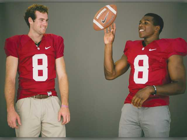 Stanford quarterback Kevin Hogan, left, and defensive back Jordan Richard pose for photos at Pac-12 media days at Paramount Studios in Los Angeles on Thursday.