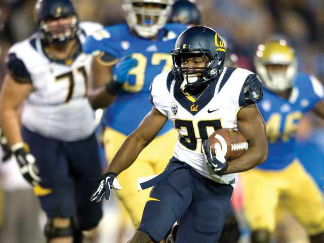 Cal running back and West Ranch graduate Jeff Coprich runs against UCLA in Pasadena on Oct. 12, 2013.