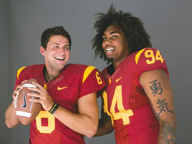 Southern California quarterback Cody Kessler, left, and defensive end Leonard Williams pose for photos at Pac-12 media days at Paramount Studios in Los Angeles on Wednesday.