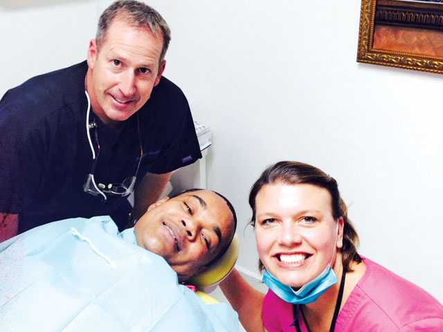 Drs. Allen, left, and Kelly, right, Smudde with a patient in Santo Domingo, Dominican Republic. Courtesy photo