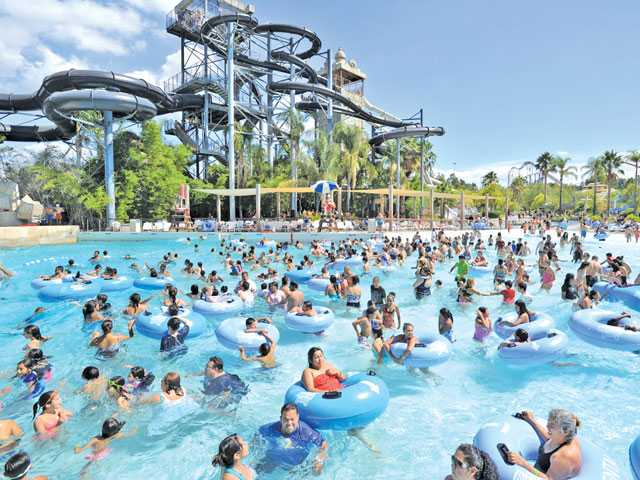 Hundreds cool off in the Forgotten Sea Wave Pool, foreground at Six Flags Hurricane Harbor last summer. Dan Watson / Signal file photo