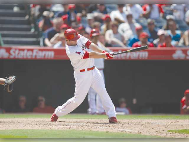 Los Angeles' David Freese hits the tie-breaking home run against the Tigers on Sunday in Anaheim.