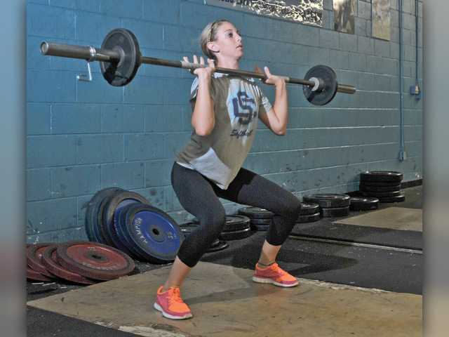 Saugus softball player Cayla Kessinger began strength training at the age of 14. She is quick to share with teammates the benefits she's received from her experience in the weight room.