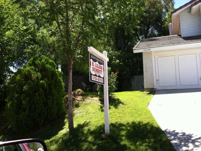 Home sales dipped in June but median prices are holding steady. Above, a home listed for sale in Saugus in July.