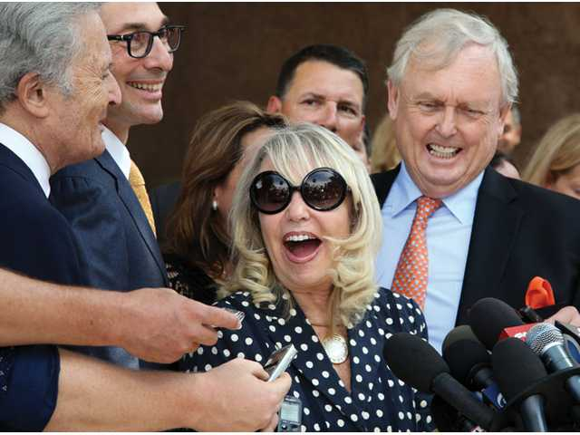 With her attorney Pierce O'Donnell, right, Shelly Sterling, center, talks to reporters outside Los Angeles Superior Court on Monday after a judge ruled in her favor and against her estranged husband, Los Angeles Clippers owner Donald Sterling, in his attempt to block the $2 billion sale of the team.
