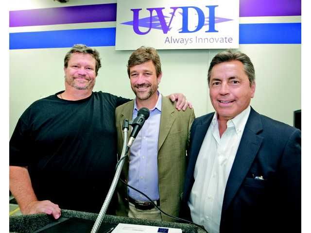 From Left, UVDI UltraViolet Devices Inc. silent partner, David Veloz, CEO and Chairman, Peter Veloz and President Richard Hayes at UVDI in Valencia. Photo by Dan Watson.