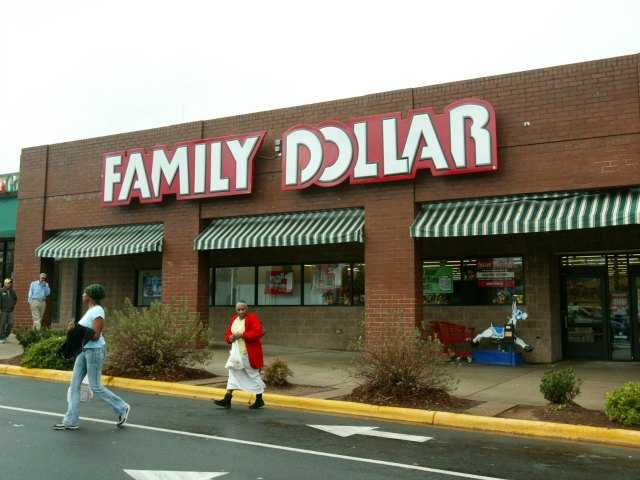 In this Tuesday, Nov. 29, 2005, file photo, customers walk past a Family Dollar store at Hickory Grove Market in Charlotte, N.C. Dollar Tree is buying rival discount store Family Dollar in a cash-and-stock deal valued at about $8.5 billion, the companies announced Monday, July 28, 2014. (AP Photo/Ross Taylor, File)