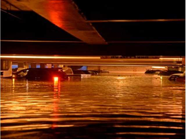 Vehicles are inundated in several feet of water in a parking structure on the UCLA campus after flooding from a broken 30-inch water main under nearby Sunset Boulevard inundated a large area of the campus in the Westwood section of Los Angeles on Tuesday.