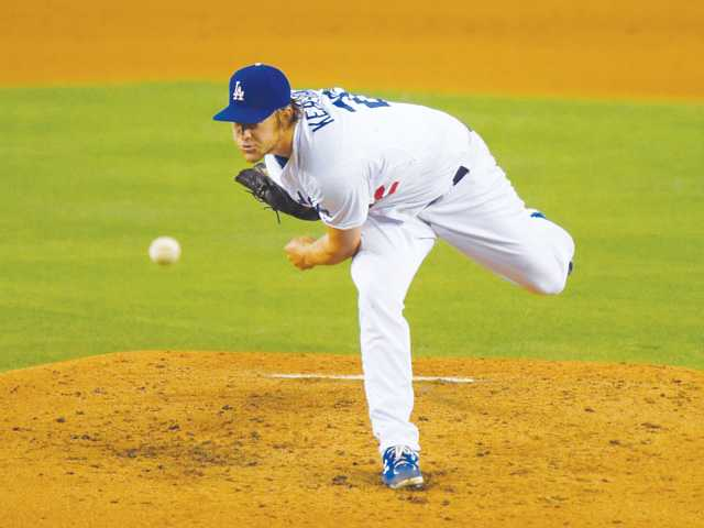 Los Angeles Dodgers pitcher Clayton Kershaw throws to the Atlanta Braves on Thursday in Los Angeles.