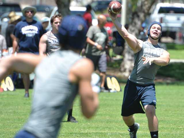 Saugus High quarterback Chris Hamilton passes to a teammate on June 29 at the Saugus Under the Lights Passing Tournament. Saugus' passing tournament is the premier event of its kind in the Santa Clarita Valley.