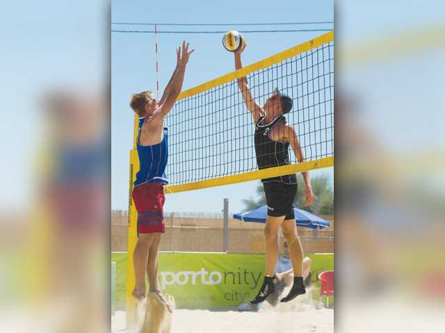 Valencia High's Kyle Ensing, left, blocks a shot during a match agianst Tom van Steenis of the Netherlands on Tuesday in Portugal. Photo courtesy of FIVB