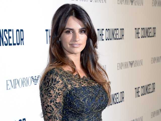 "In this Oct. 3, 2013 file photo, Spanish actress Penelope Cruz poses for photographers as she arrives for the UK Premiere of ""The Counselor,"" in London."