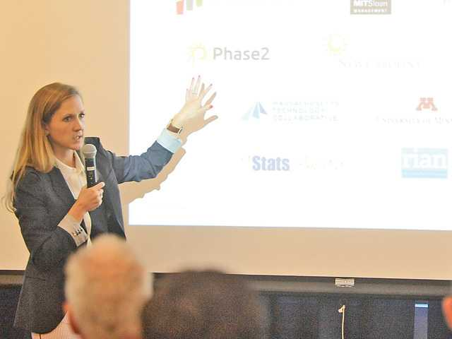 Sarah Jane Maxted, manager of Harvard Business School's Institute for Strategy and Competitiveness, speaks at the cluster mapping event at College of the Canyons.