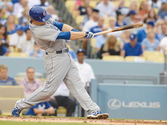 Hart alumnus and Chicago Cubs infielder Chris Valaika swings during the first inning of Saturday's game against the Los Angeles Dodgers.