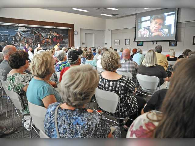 A crowd of approximately 150 attended the local premiere of the historical documentary entitled 'Harvey Girls: Opportunity Bound' presented by the Santa Clarita Valley Historical Society at the Newhall Library in Newhall on Saturday.