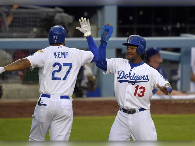 Los Angeles Dodgers' Matt Kemp, left, is congratulated by Hanley Ramirez after hitting a two-run home run against the Chicago Cubs on Saturday in Los Angeles.