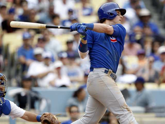 Chicago Cubs' Chris Coghlan hits a two-run home run against the Los Angeles Dodgers on Sunday in Los Angeles.