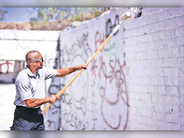 A member of the city of Santa Clarita's Graffiti Task Force works to clean a graffiti-plauged area of Canyon Country. Signal photo by Austin Dave.
