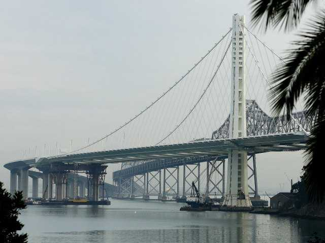 In this Jan. 7, 2014, file photo, work continues on the new eastern span of the San Francisco Oakland Bay Bridge in San Francisco.