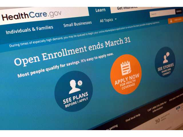 This March 1, 2014 file photo shows part of the website for HealthCare.gov, seen in Washington. President Barack Obama's health care law has become a tale of two Americas.