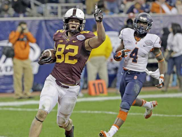 Minnesota wide receiver and Canyon High graduate Drew Wolitarsky (82) celebrates after scoring a touchdown against Syracuse during the Texas Bowl in December 2013, in Houston.