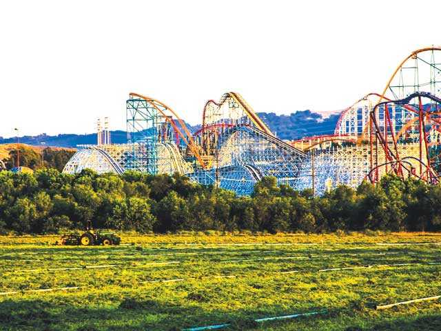 "John Glass titled this photo ""The real backyard of Six Flags Magic Mountain."" The image shows the striking dissimilarity between Magic Mountain and the rural magic of Santa Clarita Valley. John Glass / Courtesy photo"