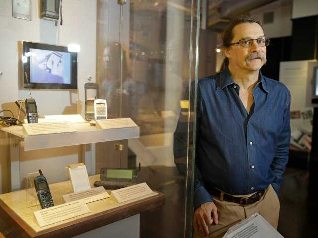 In this photo taken Wednesday, July 30, 2014, Silicon Valley pioneer and Silent Circle co-founder Jon Callas poses by a mobile phone display at the Computer History Museum in Mountain View, Calif.