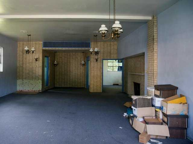 A view of the inside of the former Minus Funeral Home in Dover, Del., Thursday, Aug. 7, 2014, where police say the cremated remains of nine victims of a 1978 mass cult suicide-murder in Jonestown, Guyana, were discovered.