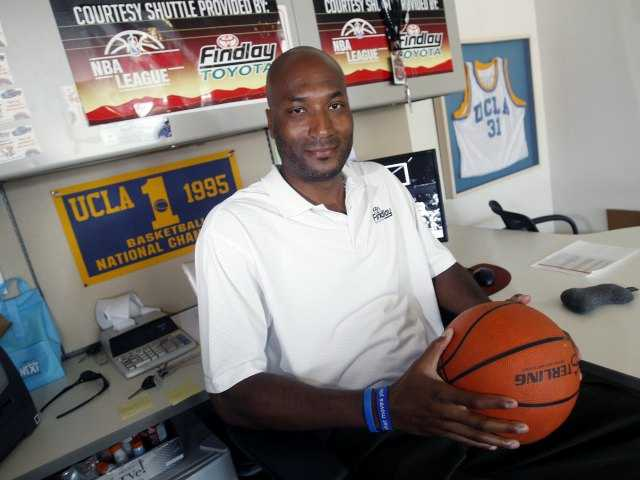 In this Sept. 18, 2010, file photo, former UCLA basketball player Ed O'Bannon Jr. sits in his office in Henderson, Nev. A federal judge ruled Friday, Aug. 8, 2014 that the NCAA can't stop college football and basketball players from selling the rights to their names and likenesses, opening the way to athletes getting payouts once their college careers are over. (AP Photo/Isaac Brekken, File)