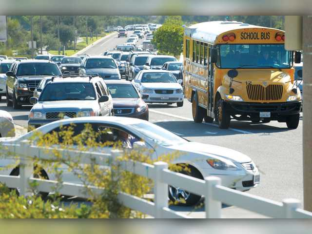 This August 2012 file photo shows traffic heading for West Ranch High School on Valencia Blvd. on the first day of school in Stevenson Ranch.