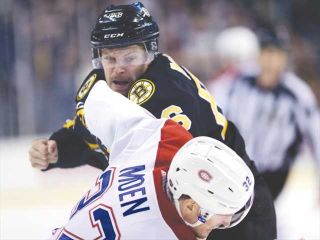 Boston Bruins defenseman Kevan Miller fights Montreal Canadiens left wing Travis Moen (32) during the first period of an NHL hockey game in March in Boston.