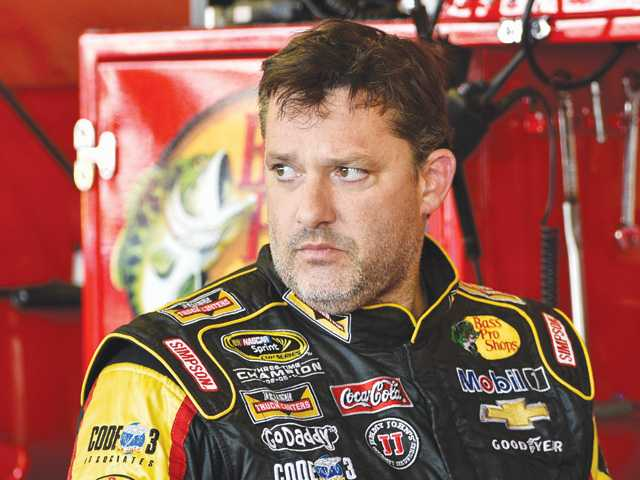 Tony Stewart stands in the garage area Friday after a practice session the NASCAR race at Watkins Glen International in Watkins Glen, N.Y.