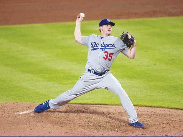Los Angeles Dodgers pitcher Kevin Correia works against the Atlanta Braves on Monday in Atlanta.