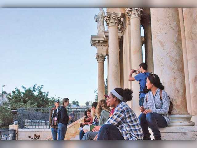 In this photo dated Jan. 2014, IBEX students sit near the Church of All Nations and the Garden of Gethsemane in Jerusalem.