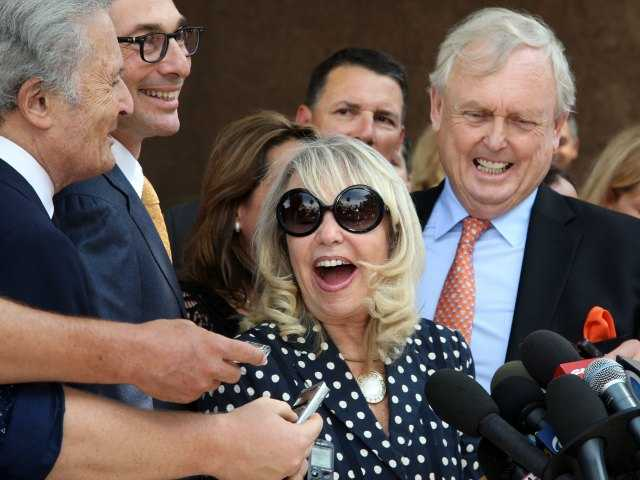 In this July 28, 2014, file photo, with her attorney Pierce O'Donnell, right, Shelly Sterling, center, talks to reporters after a judge ruled in her favor and against her estranged husband, Los Angeles Clippers owner Donald Sterling, in his attempt to block the $2 billion sale of the NBA basketball team, outside Los Angeles Superior Court. (AP Photo/Nick Ut, File)