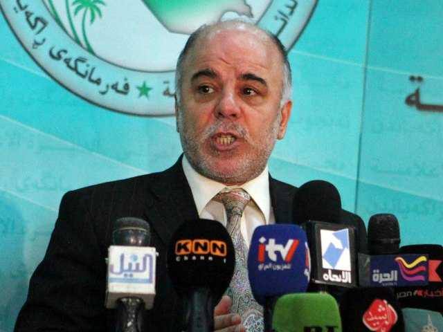 In this Saturday, Dec. 5, 2009 file photo, Shiite lawmaker Haider al-Abadi speaks to the press after an Iraqi Parliament session about the election law in Baghdad, Iraq. (AP Photo/Karim Kadim, File)