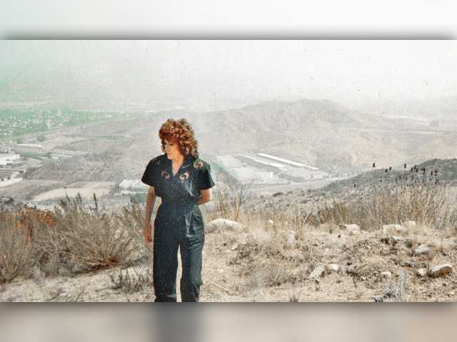 In this 1993 photo, Connie Worden-Roberts envisions the future cross-valley connector. Photo courtesy of Leon Worden