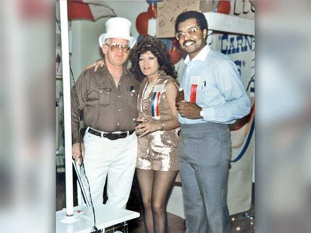 Connie Worden-Roberts, a longtime Boys & Girls Club of Santa Clarita Valley board member, stands with supporter Mike Kline, left, and then-club executive Jim Ventress at a 1986 benefit auction. Photo courtesy of Leon Worden
