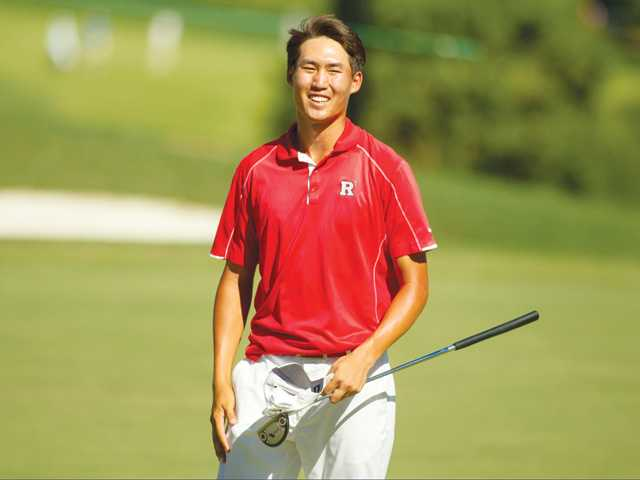 Jonathan Chang smiles after winning his match on the 16th hole during the first round of match play at the 2014 U.S. Amateur at Atlanta Athletic Club in Johns Creek, Ga. on Wednesday.