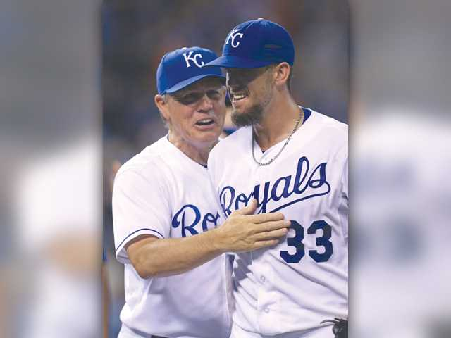Hart graduate and Royals starting pitcher James Shields (33) celebrates his complete game shutout against the San Francisco Giants with manager Ned Yost after Saturday's game in Kansas City, Mo.