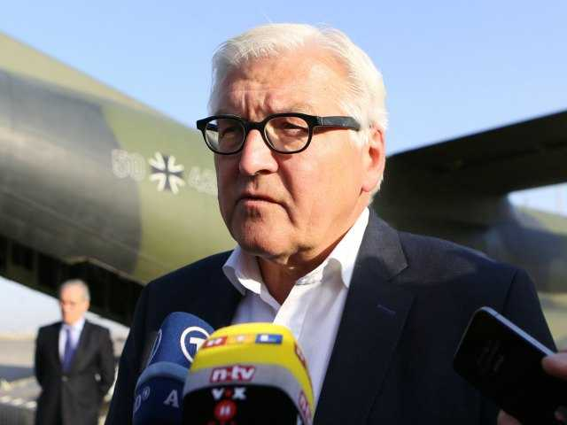 German's Foreign Minister Frank-Walter Steinmeier, speaks to the press upon his arrival at the airport in Baghdad, Iraq, Saturday, Aug 16, 2014. (AP Photo/Hadi Mizban, Pool)