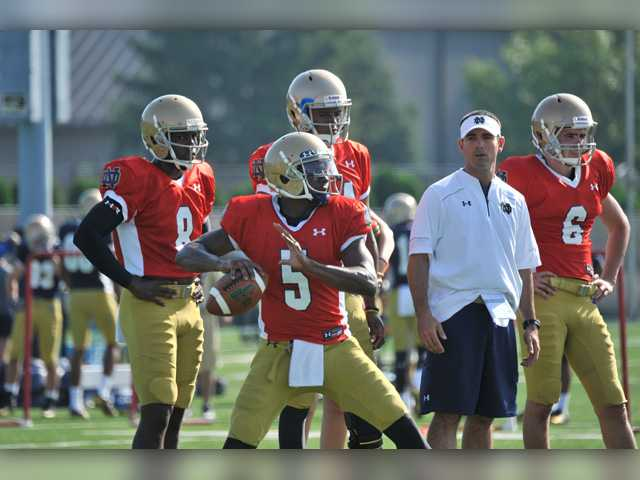 Notre Dame quarterback Everett Golson works on footwork as quarterback coach Matt LaFleur, right, and quarterback Malik Zaire, left, look on Aug. 9 in South Bend, Ind. Notre Dame opens the season against Rice at home Saturday Aug. 30.