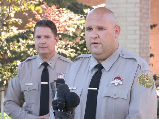 Sheriff's deputy Joshua Dubin announces the arrest of a 15-year-old boy in connection to threats of a school shooting made on social media outside the Santa Clarita Valley Sheriff's Station in Valencia on Sunday. Photo by Kristine Alfaro for The Signal.